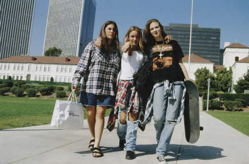 1990 grunge fashion style girls skateboard dirty photo ripped jeans rocker tee